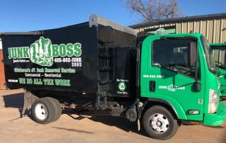 Junk Boss service vehicles used to deliver dumpsters